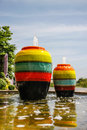 Colorful jar pot fountain in pond front of entrance door Royalty Free Stock Photo