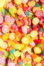 Colorful jellies and candies sweets heart-shaped background Royalty Free Stock Photo
