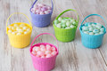 Colorful jelly beans in baskets for easter pastel brightly colored Stock Image