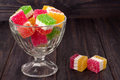 Colorful jelly candy in a glass vase on  wooden background Royalty Free Stock Photo