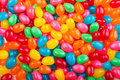 Colorful jellybeans bright in red green pink blue yellow and orange colors Stock Photo