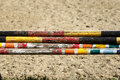 Colorful image of show jumping poles stacked at the show jumping Royalty Free Stock Photo
