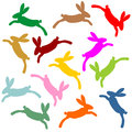 Colorful jumping bunnies as silhouette Stock Photo