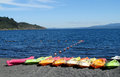 Colorful kayaks on a lake shore Royalty Free Stock Photo