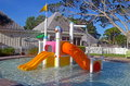 Colorful kiddie pool wading with water slides sprinklers and showers Royalty Free Stock Photography