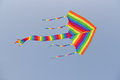 Colorful kite with long tails flying against clear blue sky Stock Images