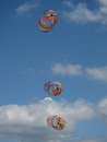 Colorful kites on blue sky with white clouds Stock Image
