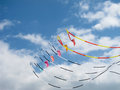 Colorful kites on blue sky with white clouds Royalty Free Stock Photography