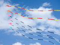 Colorful kites on blue sky with white clouds Stock Photo