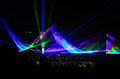 Colorful laser show rainbow colored at night Stock Images
