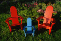 Colorful lawn chairs in garden Stock Photo