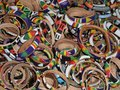 Colorful leather bracelets full frame abstract background with lots of made of Royalty Free Stock Photo