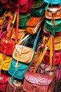 Colorful leather handbags collection on Tunis market Royalty Free Stock Photo
