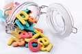 Colorful letters in the jar Stock Photography