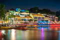 Colorful light building at night in Clarke Quay, located within the Singapore River Area. Royalty Free Stock Photo