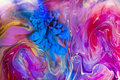 Colorful liquids underwater.  Blue color cloud and pink mix. Royalty Free Stock Photo