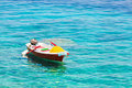 Colorful little boat on water Royalty Free Stock Photo