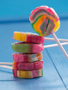 Colorful lollipops before blue background Royalty Free Stock Photo
