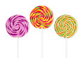 Colorful lolly pops three in front of white background Royalty Free Stock Image