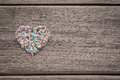Colorful love heart on wood background with space for text Royalty Free Stock Photo