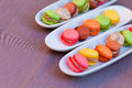 Colorful macaron on the plate isolated a purple background Royalty Free Stock Photos