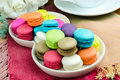 Colorful macarons on white plate