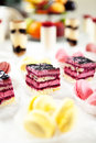 Colorful macaroons and biscuit cake buffet served sweets cakes Royalty Free Stock Photo