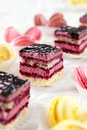 Colorful macaroons and biscuit cake buffet served sweets cakes Royalty Free Stock Photography