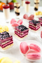 Colorful macaroons and biscuit cake buffet served sweets cakes Stock Images