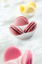 Colorful macaroons buffet served sweets and cake on a white tablecloth Stock Photo