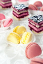 Colorful macaroons and cake buffet served sweets biscuit cakes Royalty Free Stock Images
