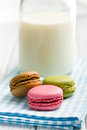 Colorful macaroons on checkered napkin with milk Stock Photos