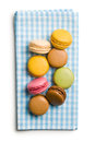 Colorful macaroons on checkered napkin white background Stock Image