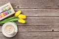 Colorful macaroons, coffee cup and yellow tulips