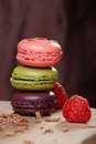 Colorful macaroons stacked on wooden plate Stock Photos