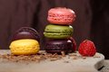 Colorful macaroons stacked on wooden plate Stock Photography
