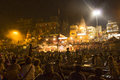 Colorful main ghat in varanasi by india may crowds of people worshiping bathing the sacred river ganges night at on may india Royalty Free Stock Photos