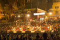 Colorful main ghat in varanasi by india may crowds of people worshiping bathing the sacred river ganges night at on may india Stock Photo