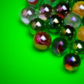 Colorful marbles over green Stock Photo