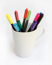 Colorful marker pens on a white glass Royalty Free Stock Photo