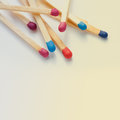 Colorful matches closeup wooden multicolored retro colors background macro view toned photo Stock Images