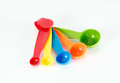 Colorful measuring spoons isolated Royalty Free Stock Photo