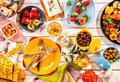 Colorful mediterranean meal on white picnic table high angle view of prepared spread out painted wooden with bright plates and Stock Image