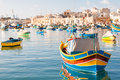 Colorful mediterranean traditional fisherman boats in marsaxlokk malta typical village the south east of early winter morning Stock Image