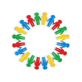 Colorful men of colored paper placed in a circle on a white background Royalty Free Stock Photography