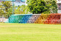 Colorful metal grandstand on green playground Royalty Free Stock Image