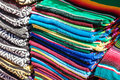 Colorful Mexican serapes hang in row Royalty Free Stock Photo