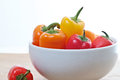 Colorful mini sweet peppers in a white bowl Stock Photos