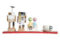 Colorful mini wooden robot models and coffee cup on red shelf is