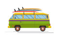 Colorful minibus with surfing boats on the roof